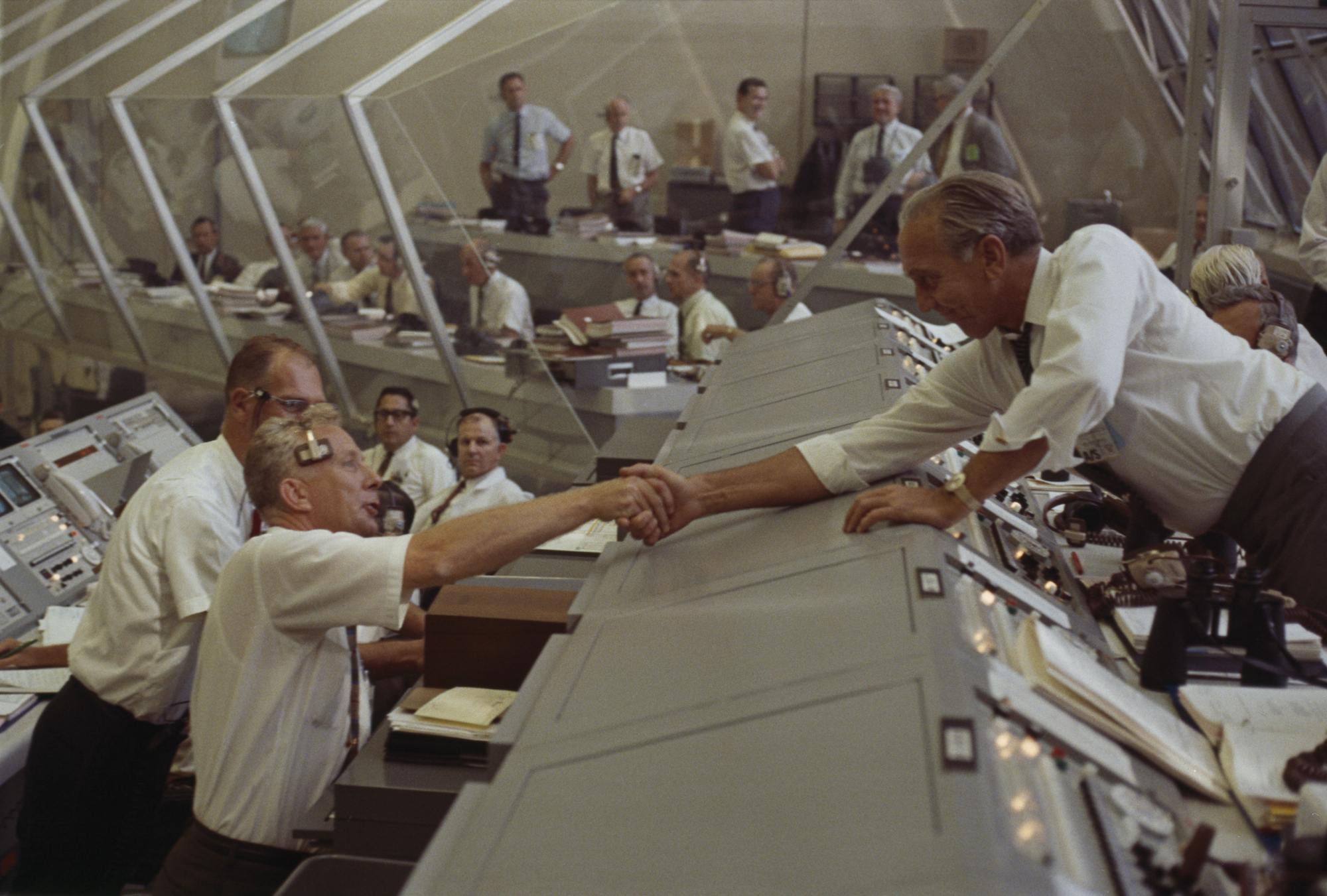 Flurry of handshakes erupts after successful launch of Apollo 11. (NASA)