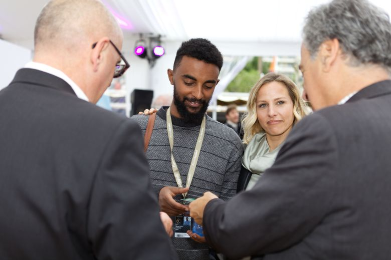 Beza Hailu Lemma with Emma Smith exchanging cards with Gregg Schwenk Steve Shor from the Newport Beach Film Festival