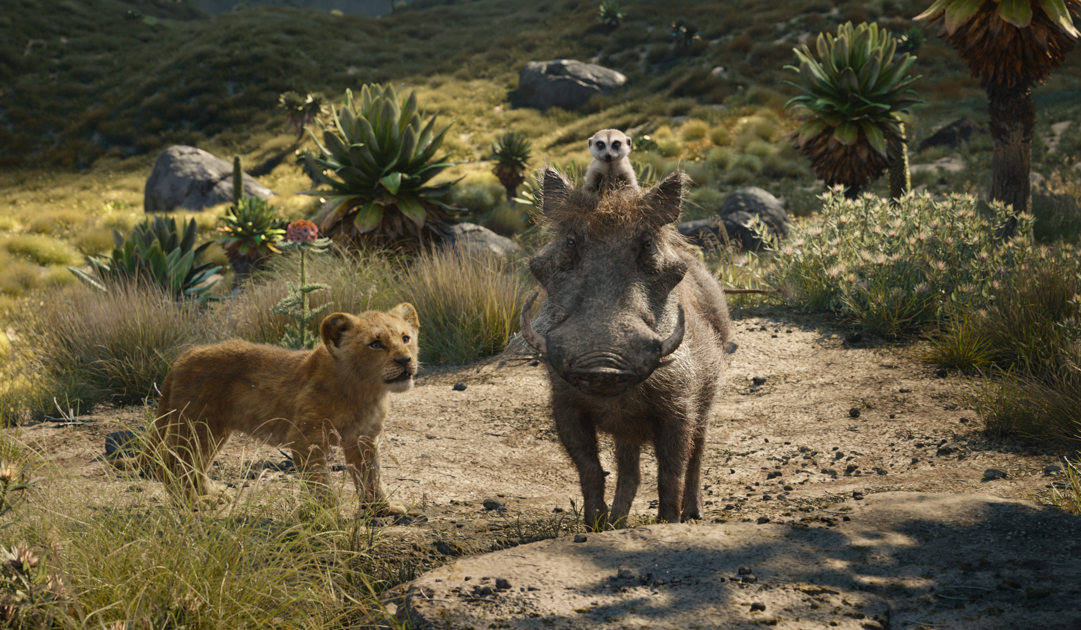 """THE LION KING - Featuring the voices of JD McCrary as Young Simba, Billy Eichner as Timon and Seth Rogen as Pumbaa, Disney's """"The Lion King"""" is directed by Jon Favreau. In theaters July 19, 2019. © 2019 Disney Enterprises, Inc. All Rights Reserved."""