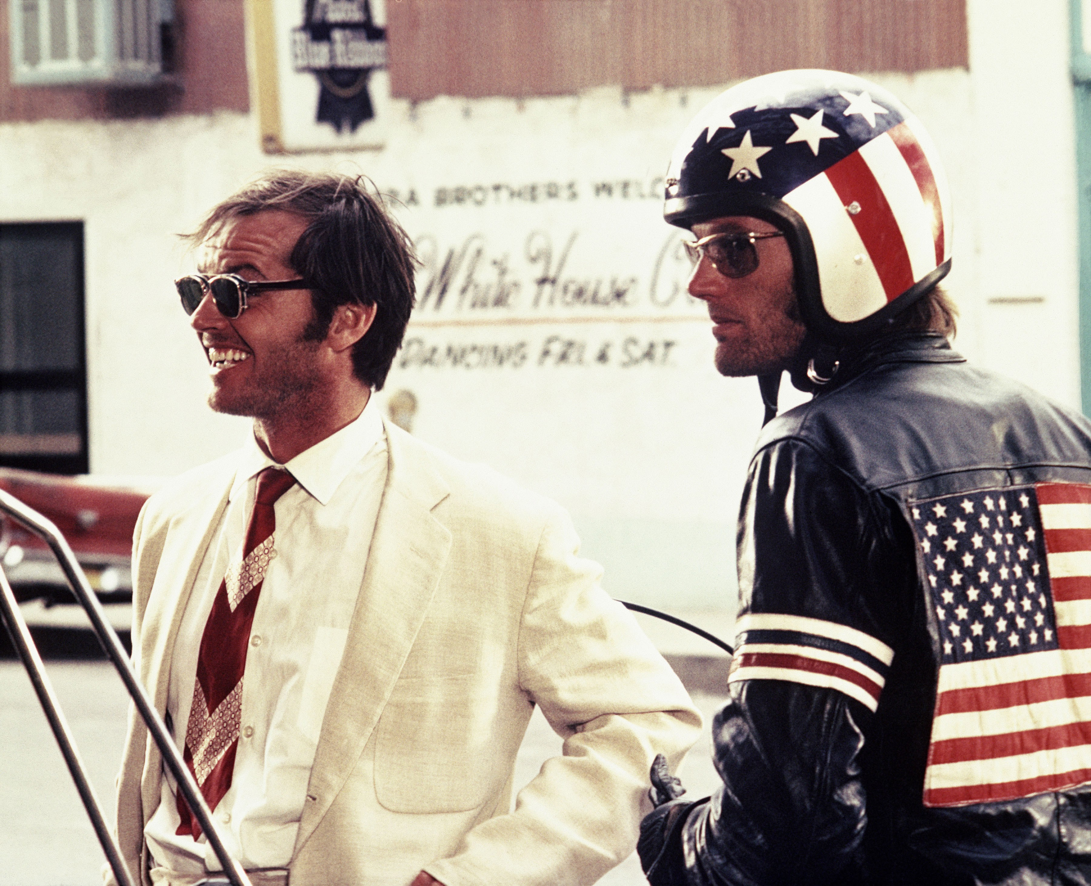 Editorial use only. No book cover usage.Mandatory Credit: Photo by Columbia/Kobal/Shutterstock (5885924af) Jack Nicholson, Peter Fonda Easy Rider - 1969 Director: Dennis Hopper Columbia USA Scene Still Drama