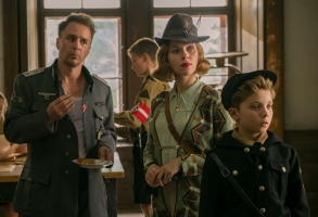 (From L-R): Sam Rockwell, Scarlett Johansson and Roman Griffin Davis in the film JOJO RABBIT. Photo by Larry Horricks. © 2019 Twentieth Century Fox Film Corporation All Rights Reserved