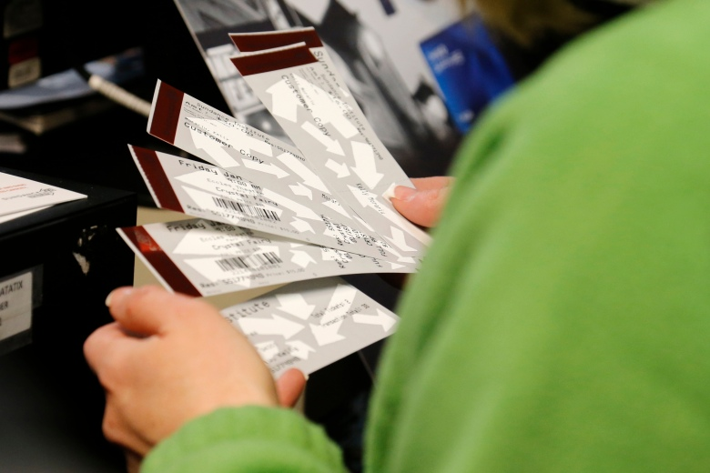 A festival attendee holds movie tickets inside the box office during the 2013 Sundance Film Festival on in Park City, Utah 2013 Sundance Film Festival - Day 1, Park City, USA - 17 Jan 2013