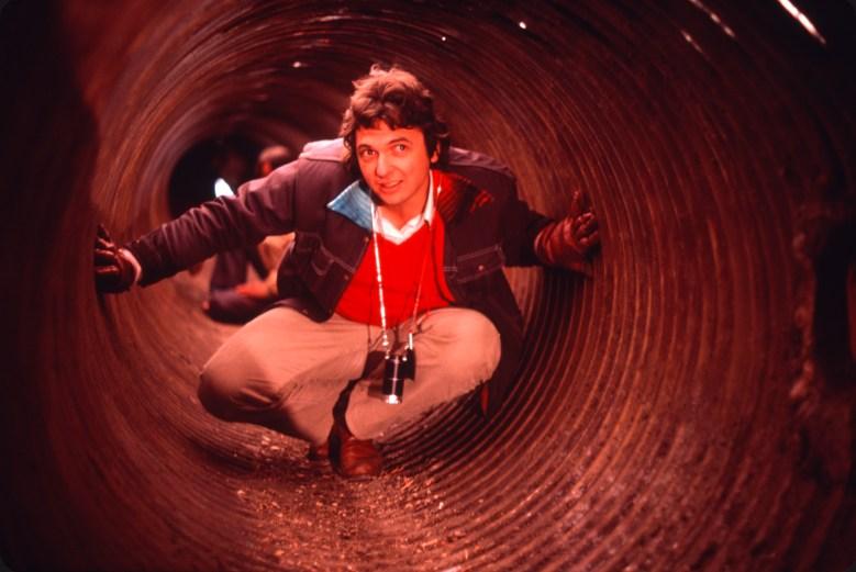 El Norte director Gregory Nava in the tunnel set behind the scenes