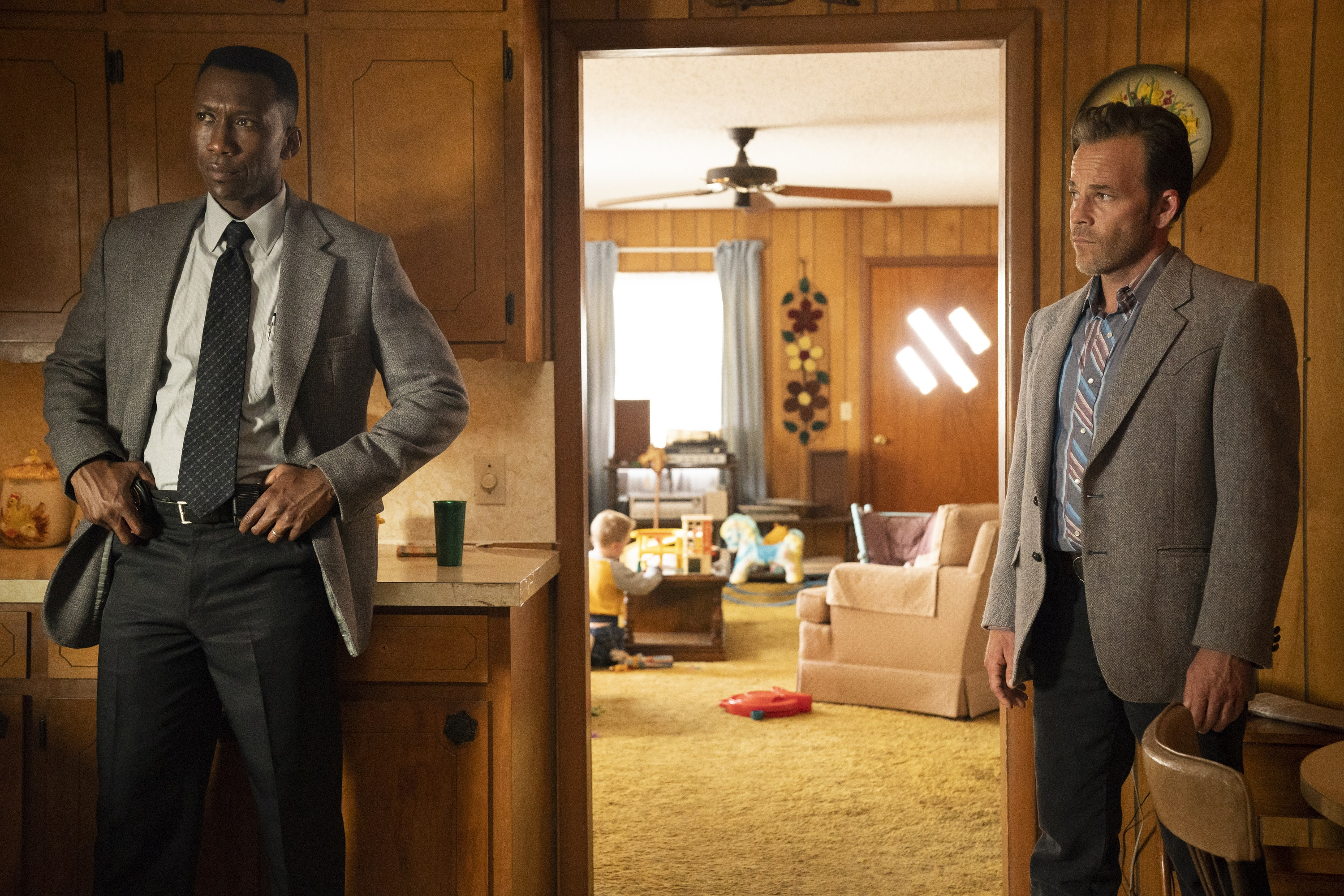 Wayne & Roland question Freddy about the case. (Warrick Page/HBO)