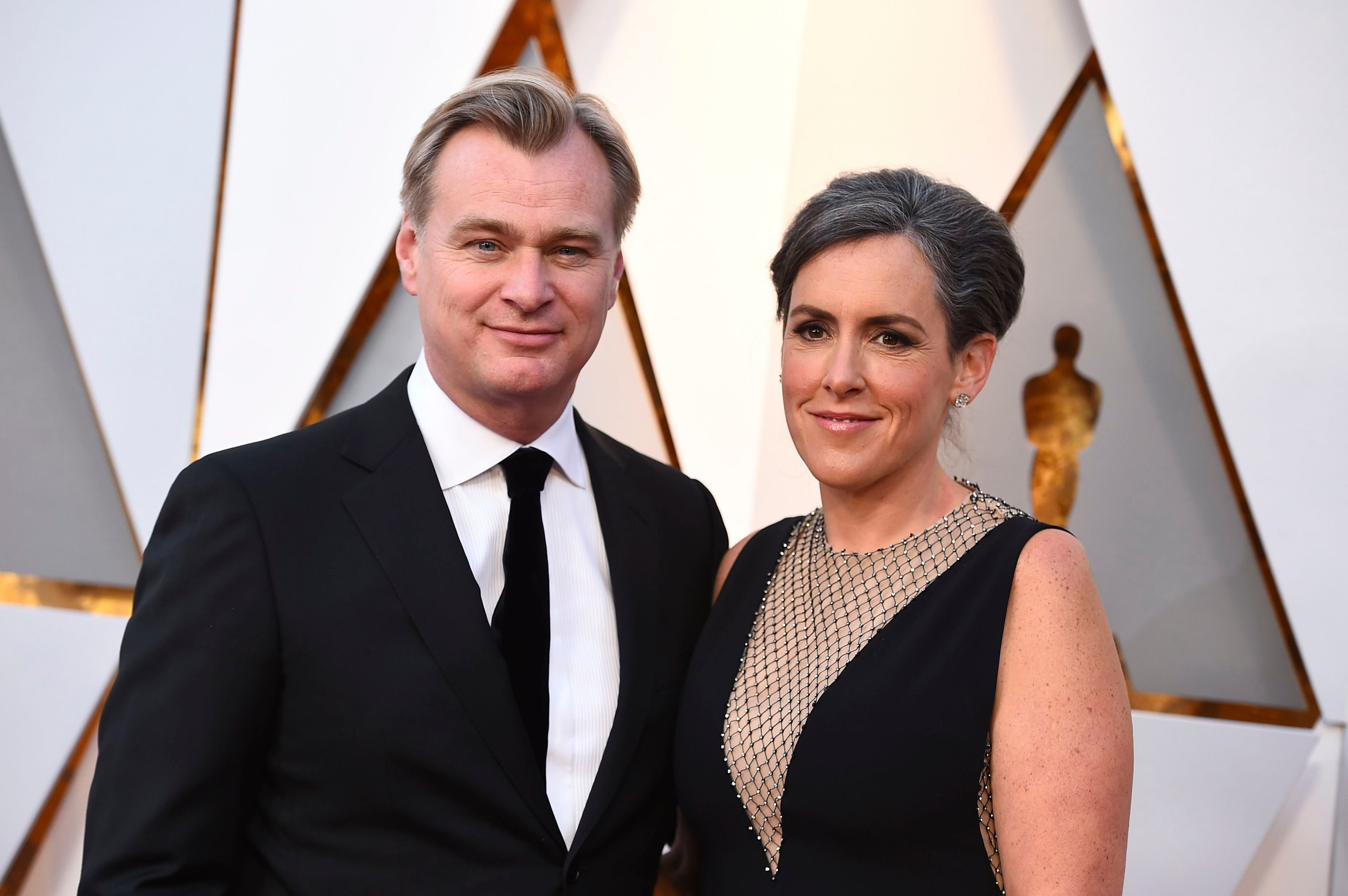 Christopher Nolan, Emma Thomas. Christopher Nolan, left, and Emma Thomas arrive at the Oscars, at the Dolby Theatre in Los Angeles90th Academy Awards - Arrivals, Los Angeles, USA - 04 Mar 2018