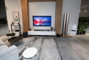 """CES 2018 attendees admire the breathtaking """"wallpaper"""" design and stunning OLED picture quality of the LG SIGNATURE OLED 4K HDR Smart TV at the LG Electronics booth during 2018 International CES, in Las VegasLG Booth Day 1 CES 2018, Las Vegas, USA - 09 Jan 2018"""