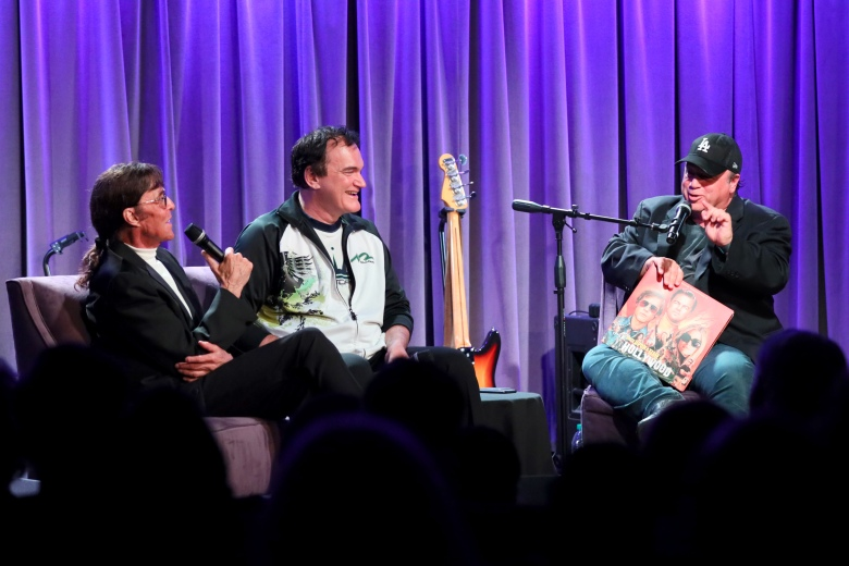 LOS ANGELES, CALIFORNIA - OCTOBER 02: Mark Lindsay and Quentin Tarantino speak with David Wild at Once Upon A Time In Hollywood: An Evening With Quentin Tarantino & Friends at the GRAMMY Museum on October 02, 2019 in Los Angeles, California. (Photo by Rebecca Sapp/Getty Images for The Recording Academy )