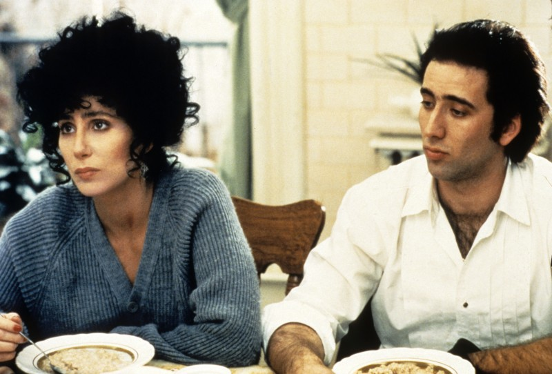Editorial use only. No book cover usage. Mandatory Credit: Photo by Mgm/Kobal/Shutterstock (5883923z) Cher, Nicolas Cage Moonstruck - 1987 Director: Norman Jewison MGM USA Scene Still Eclair de lune