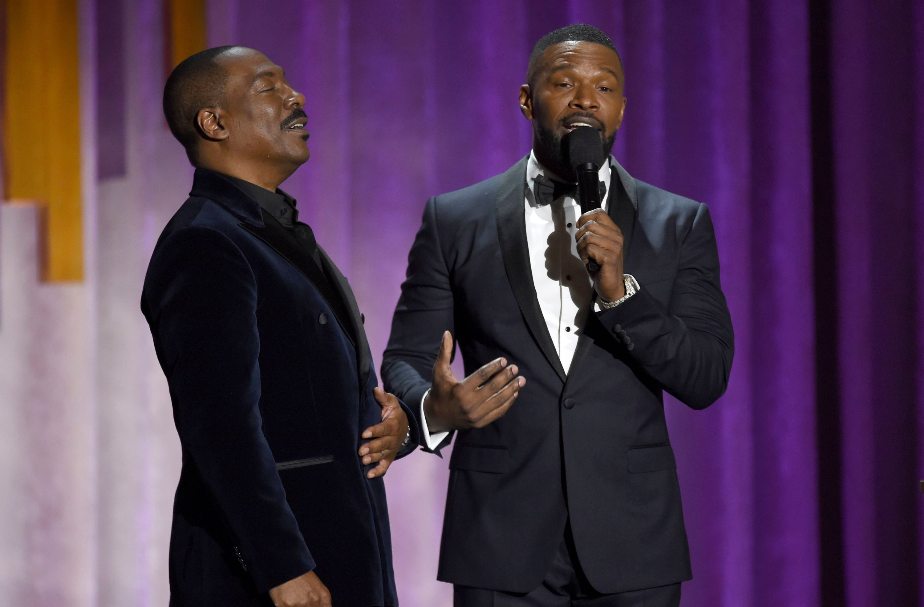 Eddie Murphy, Jamie Foxx. Eddie Murphy, left, and Jamie Foxx speak on stage at the Governors Awards, at the Dolby Ballroom in Los Angeles2019 Governors Awards - Show, Los Angeles, USA - 27 Oct 2019