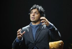 "M. Night Shyamalan speaks on stage during the ""A Night with M. Night: Introducing Servant on Apple TV+"" panel at Hammerstein Ballroom on the first day of New York Comic Con, in New York2019 Comic Con, New York, USA - 03 Oct 2019"
