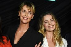 "Margot Robbie, Charlize Theron. Cast members Charlize Theron, left, who plays Megyn Kelly, and Margot Robbie, who plays Kayla Pospisil, pose at a Los Angeles special screening of ""Bombshell,"" at the Pacific Design CenterLA Special Screening of ""Bombshell"", West Hollywood, USA - 13 Oct 2019"