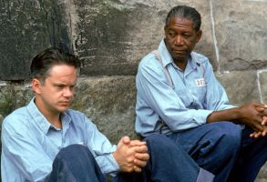 "Editorial use onlyMandatory Credit: Photo by ITV/Shutterstock (770117ra)'The Shawshank Redemption' Film Andy Dufresne (Tim Robbins), Right, and Ellis Boyd ""Red"" Redding (Morgan Freeman) , Who Wears a Baseball Glove, Chat Whilst Kneeling Down, in the Prison CourtyardGTV ARCHIVE"