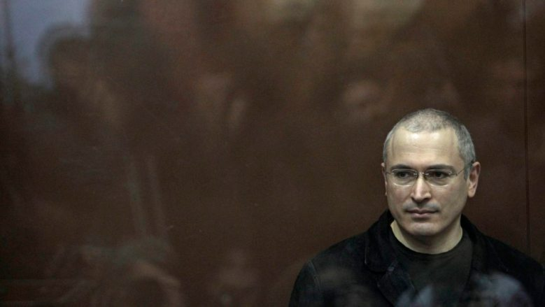 Mikhail Khodorkovsky stands behind bars at a court room in Moscow, Monday, Dec. 27, 2010. A Russian judge starts delivering the verdict in the second trial of jailed oil tycoon Mikhail Khodorkovsky, once Russia's richest man who is serving an eight-year sentence in a case widely seen as punishment for challenging the Kremlin and is now facing several more years in prison if convicted. (AP Photo/Sergey Ponomarev)