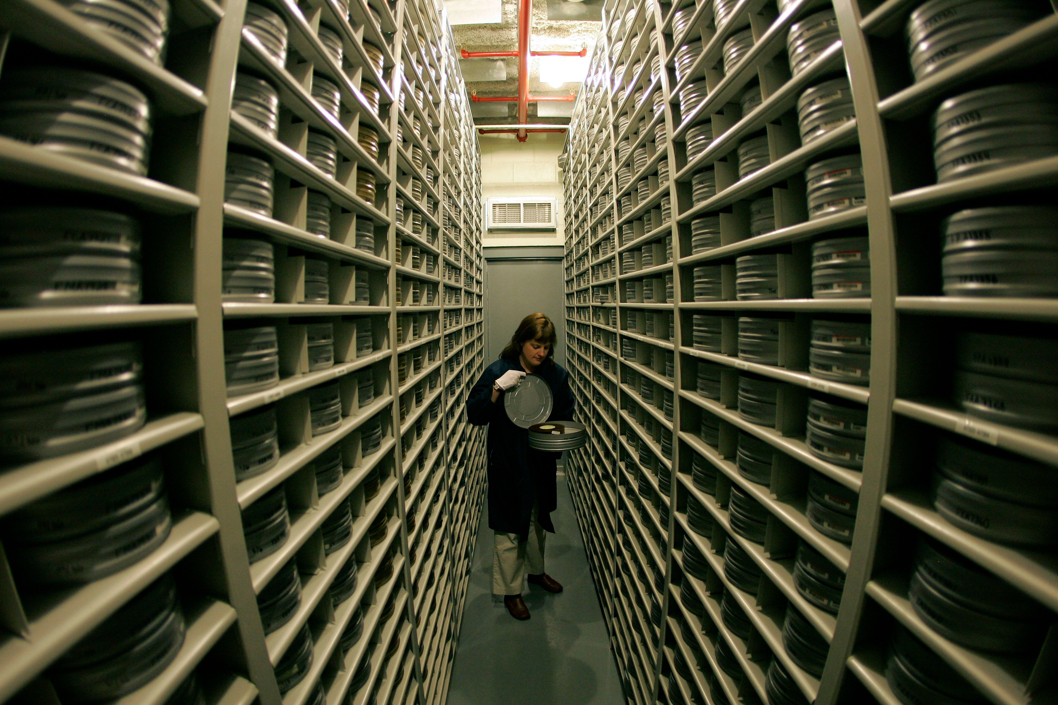 Deborah Stoiber looks for a movie inside the nitrate film vault at the George Eastman House Louis B. Mayer Conservation Center in Chili, N.YPreserving Old Movies, Chili, USA