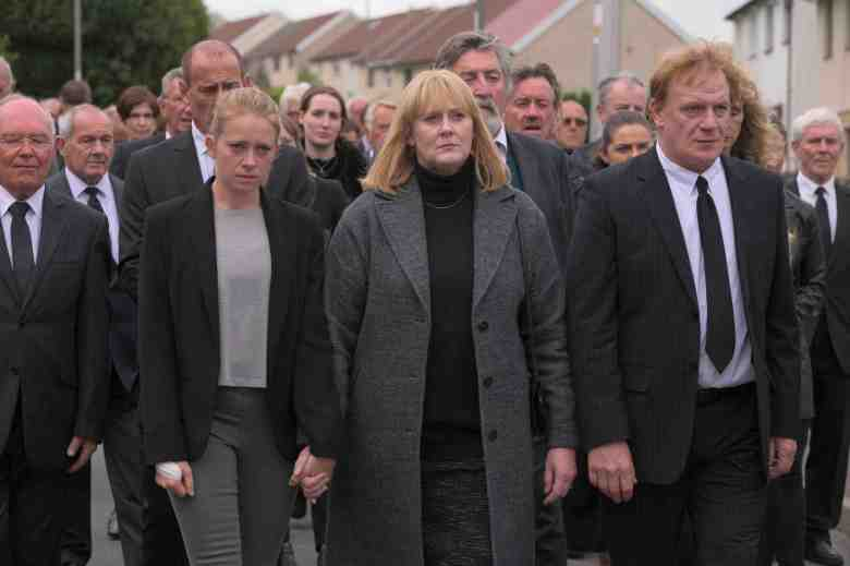 "The Accident -- ""Episode 2"" -- In the aftermath of the tragedy, Polly worries that Iwan might be hiding something. Angela gathers the families to fight for justice, and as Harriet faces questions at work, her assistant and lover, Tim, acts to protect her by leaking information that drives a wedge through the town. Debbie (Genevieve Barr), Polly (Sarah Lancashire) and Iwan (Mark Lewis Jones), shown. (Photo by: Warren Orchard/The Forge/Hulu)"