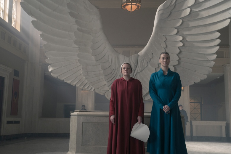 """The Handmaid's Tale -- """"Household"""" - Episode 306 -- June accompanies the Waterfords to Washington D.C., where a powerful family offers a glimpse of the future of Gilead. June makes an important connection as she attempts to protect Nichole. June (Elisabeth Moss) and Serena (Yvonne Strahovski), shown. (Photo by: Sophie Giraud/Hulu)"""