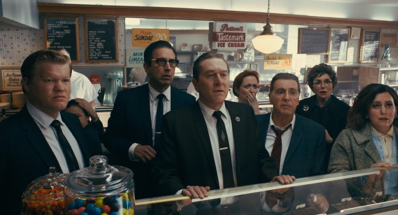 (From l to r) During a break in the trial of Jimmy Hoffa, Chuckie O'Brien (Jesse Plemons), Bill Bufalino (Ray Romano), Frank Sheeran (Robert De Niro) and Hoffa (Al Pacino) are shocked at the news of JFK's assassination. © 2019 Netlfix US, LLC. All rights reserved.