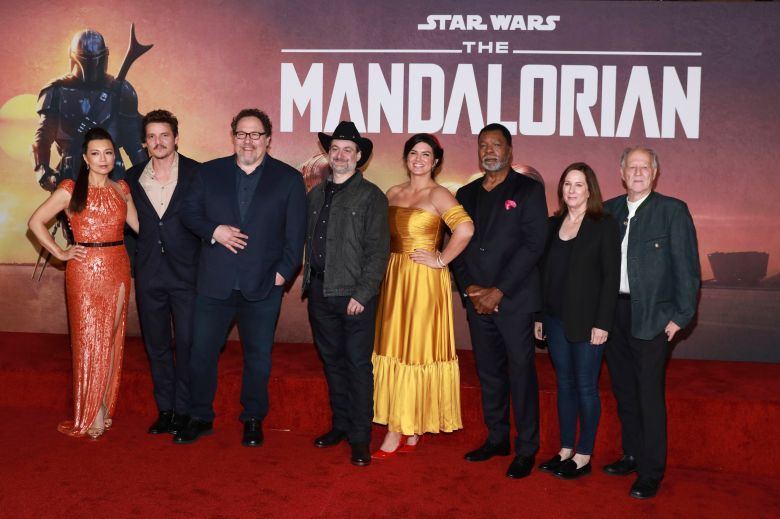 "Ming-Na Wen, Pedro Pascal, Jon Favreau, Dave Filoni, Gina Carano, Carl Weathers, Kathleen Kennedy, Werner Herzog. Ming-Na Wen, from left, Pedro Pascal, Jon Favreau, Dave Filoni, Gina Carano, Carl Weathers, Kathleen Kennedy, and Werner Herzog attend the LA Premiere of ""The Mandalorian"" at the El Capitan Theatre, in Los AngelesLA Premiere of ""The Mandalorian"", Los Angeles, USA - 13 Nov 2019"