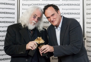 Cinematographer Robert Richardson and Quentin Tarantino winning a prize for their collaboration at Camerimage