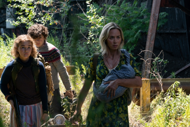 "L-r, Regan (Millicent Simmonds), Marcus (Noah Jupe) and Evelyn (Emily Blunt) brave the unknown in ""A Quiet Place Part II."""