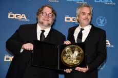 """Alfonso Cuaron, Guillermo del Toro. Guillermo del Toro, left, poses in the press room with Alfonso Cuaron, winner of the award for outstanding directorial achievement in feature film for """"Roma,"""" at the 71st annual DGA Awards at the Ray Dolby Ballroom, in Los Angeles71st Annual DGA Awards - Press Room, Los Angeles, USA - 02 Feb 2019"""