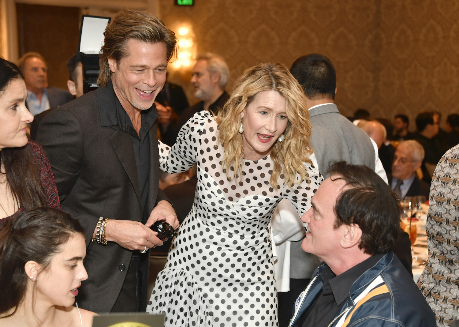 LOS ANGELES, CALIFORNIA - JANUARY 03: (L-R) Actor Brad Pitt, actor Laura Dern, and filmmaker Quentin Tarantino attend the 20th Annual AFI Awards at Four Seasons Hotel Los Angeles at Beverly Hills on January 03, 2020 in Los Angeles, California. (Photo by Frazer Harrison/Getty Images for AFI)