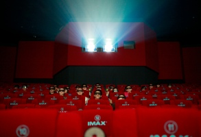 Patrons watch a 3D IMAX movie at a theater of Wanda cinema run by Dalian Wanda Group Co. in Beijing, China, . The Chinese conglomerate, Dalian Wanda Group Co. announced Monday it will buy major U.S. cinema chain, AMC Entertainment Holdings, for $2.6 billion to create the world's biggest movie theater operatorChina US Cinema Chain, Beijing, China