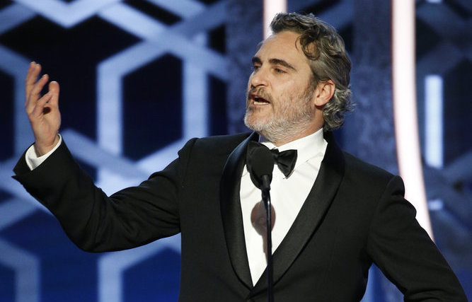 "77th ANNUAL GOLDEN GLOBE AWARDS -- Pictured: Joaquin Phoenix accepts the award for Best Actor - Motion Picture, Drama for ""Joker"" at the 77th Annual Golden Globe Awards held at the Beverly Hilton Hotel on January 5, 2020 -- (Photo by: Paul Drinkwater/NBC)"