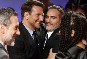 "Bradley Cooper, Joaquin Phoenix. Actors Bradley Cooper, left, and Joaquin Phoenix attend the premiere for ""Joker"" on day five of the Toronto International Film Festival at Roy Thomson Hall, in Toronto2019 TIFF - ""Joker"" Premiere, Toronto, USA - 09 Sep 2019"