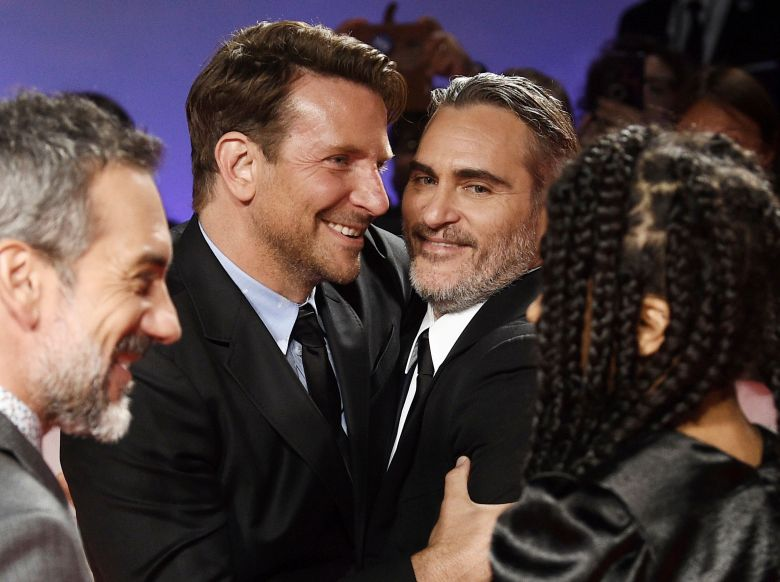 "Bradley Cooper, Joaquin Phoenix. Actors Bradley Cooper, left, and Joaquin Phoenix attend the premiere for ""Joker"" on day five of the Toronto International Film Festival at Roy Thomson Hall, in Toronto2019 TIFF - ""Joker"" Premiere, Toronto, USA - 09 Sep 2019"