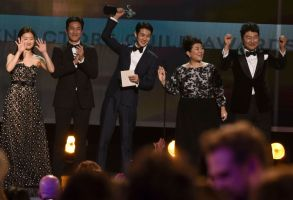 "Park So-dam, Lee Sun Gyun, Choi Woo-shik, Lee Jeong-eun, Kang-Ho Song. Park So-dam, from left, Lee Sun Gyun, Choi Woo-shik, Lee Jeong-eun and Kang-Ho Song accept the award for outstanding performance by a cast in a motion picture for ""Parasite"" at the 26th annual Screen Actors Guild Awards at the Shrine Auditorium & Expo Hall, in Los Angeles26th Annual SAG Awards - Show, Los Angeles, USA - 19 Jan 2020"