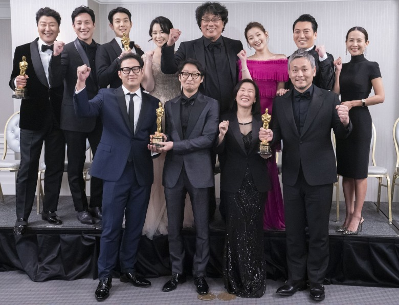 Bong Joon-ho (2nd row, 4-R) poses with key team members and stars of his film 'Parasite' at an event at London West Hollywood in Los Angeles, California, USA, 09 February 2020, after the black comedy film took four titles at the 92nd annual Academy Awards gala that was held earlier the same night at the Dolby Theatre in Hollywood. The movie won Oscars in the categories Best Picture, Directing, International Feature Film and Writing (Original Screenplay).Parasite team poses after Oscars ceremony, Los Angeles, USA - 10 Feb 2020