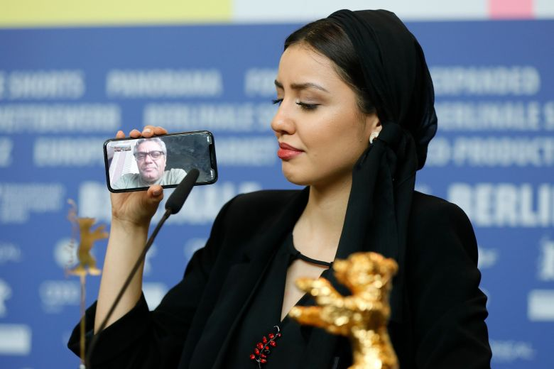 Actress Baran Rasoulof, winner of the Golden Bear on behalf of director Mohammad Rasoulof (on the phone) for the movie 'Sheytan vojud nadarad' (There Is No Evil) attends the Winners' Press Conference after the Closing and Awards Ceremony of the 70th annual Berlin International Film Festival (Berlinale), in Berlin, Germany, 29 February 2020. The Berlinale runs from 20 February to 01 March 2020.Winners' Press Conference - Closing and Awards Ceremony - 70th Berlin Film Festival, Germany - 29 Feb 2020