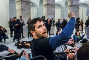 On December 18, 2017, approximately 70 protesters against the GOP Tax Bill were arrested while staging a 'die-in' in the rotunda of the Rayburn House office building. One of the arrestees was health care activist Ady Barkan, who is living with ALS. Barkan said the GOP tax bill's cuts to Medicaid will put his and 13 million other American's life at risk. (Photo by Michael Nigro)