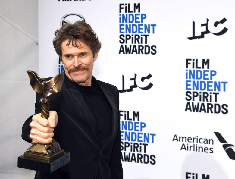 """Willem Dafoe poses in the press room with the award for best supporting male for """"The Lighthouse"""" at the 35th Film Independent Spirit Awards, in Santa Monica, Calif2020 Film Independent Spirit Awards - Press Room, Santa Monica, USA - 08 Feb 2020"""