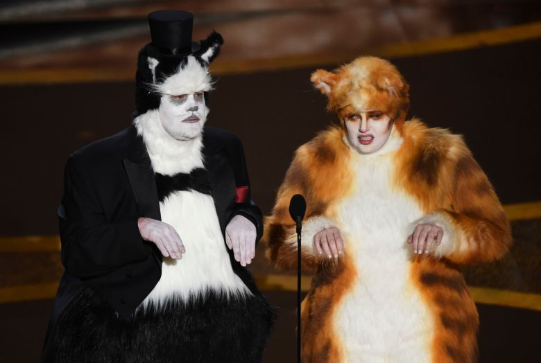James Corden, Rebel Wilson. James Corden, left, and Rebel Wilson present the award for best visual effects at the Oscars, at the Dolby Theatre in Los Angeles92nd Academy Awards - Show, Los Angeles, USA - 09 Feb 2020