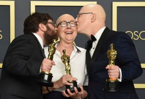 "Jeff Reichert, Julia Reichert, Steven Bognar. Jeff Reichert, from left, Julia Reichert, and Steven Bognar, winners of the award for best documentary feature for ""American Factory"", pose in the press room at the Oscars, at the Dolby Theatre in Los Angeles92nd Academy Awards - Press Room, Los Angeles, USA - 09 Feb 2020"