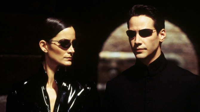 Editorial use only. No book cover usage.Mandatory Credit: Photo by Moviestore/Shutterstock (1644197a)The Matrix Reloaded (The Matrix 2), Carrie-anne Moss, Keanu ReevesFilm and Television