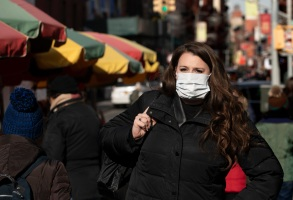 "A woman, who declined to give her name, wears a mask, in New York. She works for a pharmaceutical company and said she wears the mask out of concern for the coronavirus. ""I'd wear a mask if I were you,"" she said. For the first time in the U.S., the new virus from China has spread from one person to another, health officials said ThursdayChina Outbreak US, New York, USA - 30 Jan 2020"