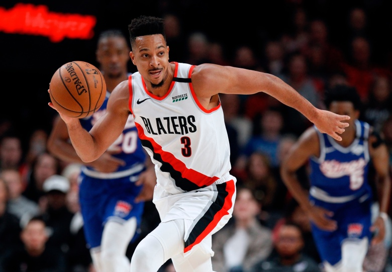 Portland Trail Blazers guard CJ McCollum pushes the ball upcourt against the Sacramento Kings during the first half of an NBA basketball game in Portland, OrePistons Trail Blazers Basketball, Portland, USA - 07 Mar 2020