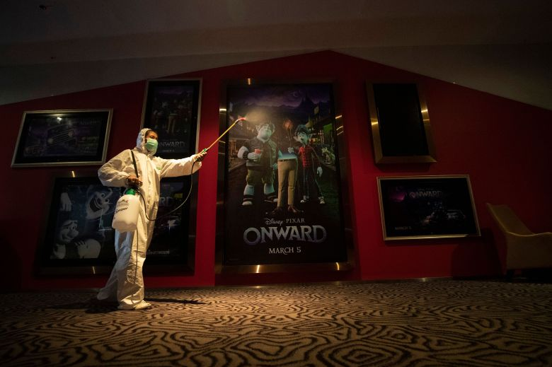 Worker sprays disinfectant as a precaution against the new coronavirus at Quartier Cineart movie theater in Bangkok, Thailand, . Thailand's government has enacted stronger measures to combat the spread of the coronavirus, including postponing the country's biggest holiday, shutting down schools, movie theaters and closing bars. For most people, the new coronavirus causes only mild or moderate symptoms. For some it can cause more severe illnessVirus Outbreak , Bangkok, Thailand - 19 Mar 2020