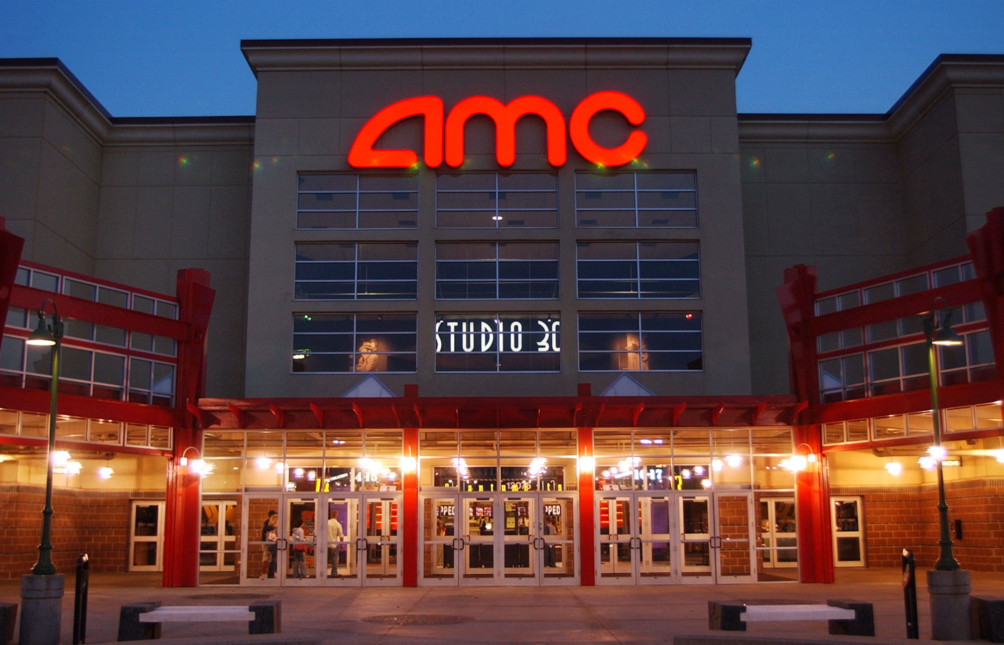People enter AMC's Studio 30 theaterAMC Theatres Odeon and UCI, Olathe, Kansas, USA - 11 May 2005AMC Theatres is buying European movie theater operator Odeon & UCI Cinemas Group in a deal valued at about 921 million pounds ($1.21 billion). AMC says, Tuesday, July 12, 2016, that the transaction will make it the biggest movie theater operator in the world. Odeon & UCI has 242 theaters in Europe. The deal will give AMC a total of 627 theaters in eight countries.
