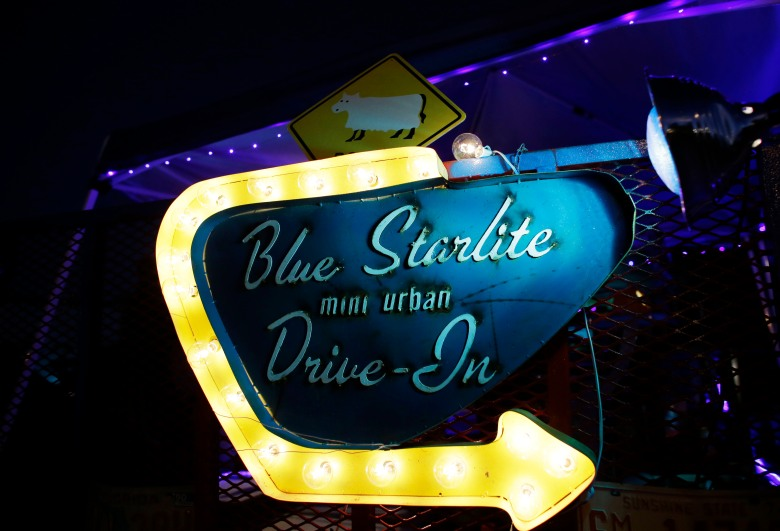 A neon sign glows on the opening night of the Blue Starlite Mini Urban Drive-In movie theater, Friday, Oct.11, 2013, in the Wynwood neighborhood of Miami. The theatre was opened by Josh Frank, 38, of Miami Beach, Fla., who has another outdoor theater in Austin, TexasFlorida Daily Life, Miami, USA