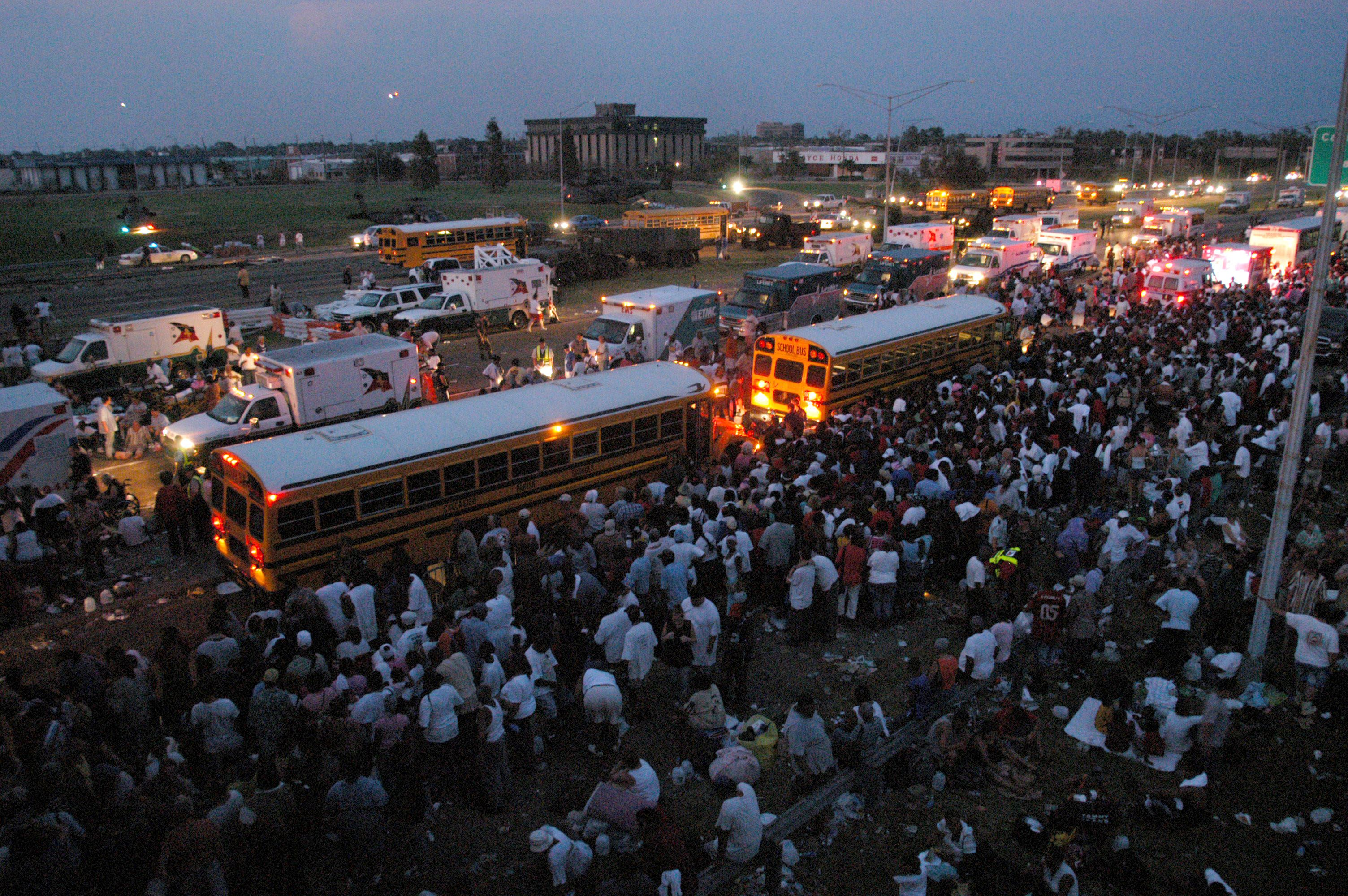 Rescue activities continue into the night at the main staging area at I-10 and Causeway, New Orleans - 31 AugHURRICANE KATRINA, AMERICA - 2005