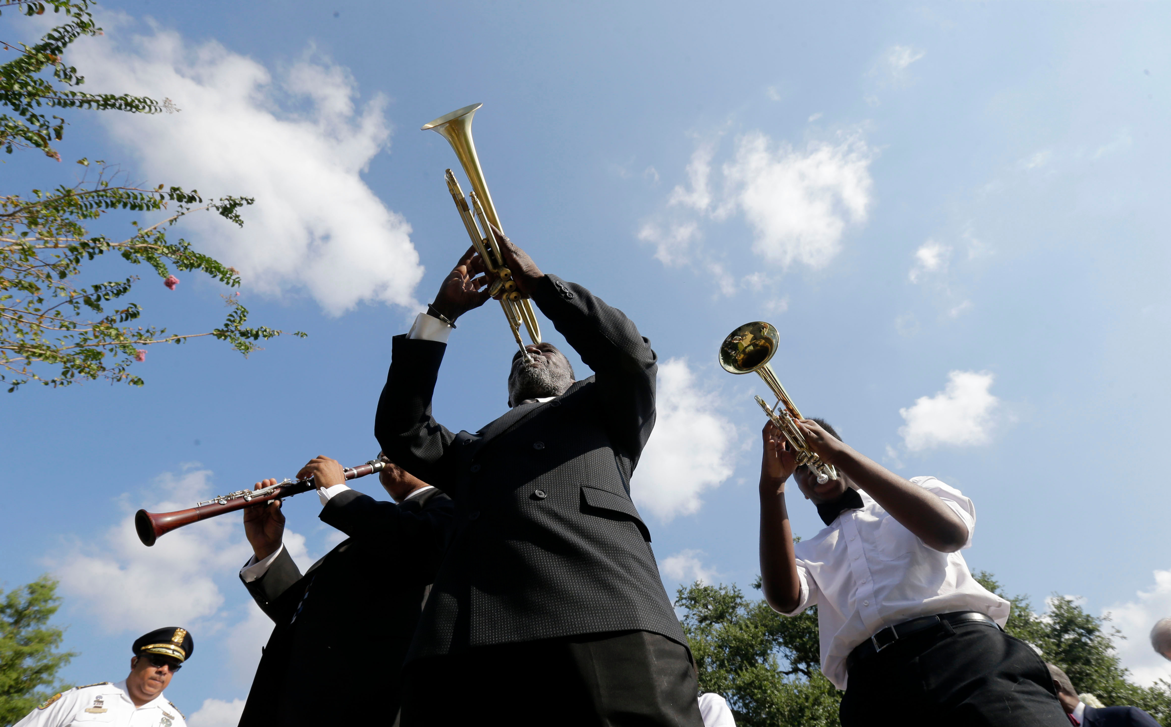 AP10ThingsToSee - Musicians lead a procession during a wreath laying ceremony at the Hurricane Katrina Memorial on the 10th anniversary of Hurricane Katrina in New Orleans onAP10ThingsToSee Katrina Anniversary, New Orleans, USA