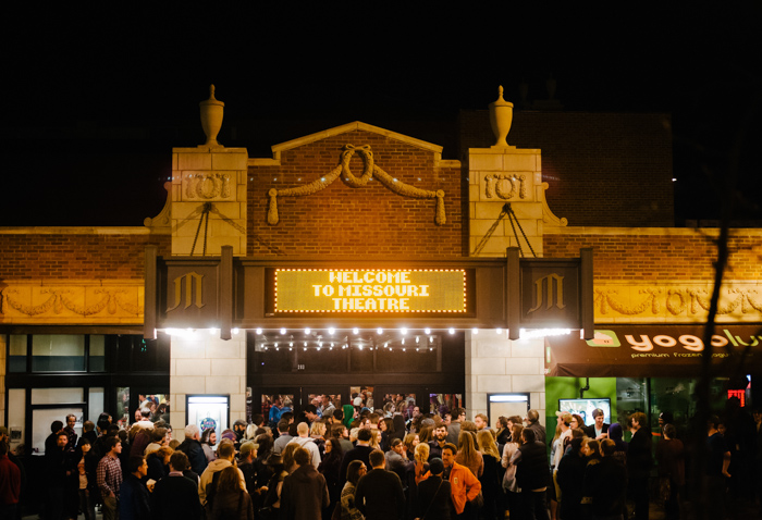 A large crowd gathers inside and outside the Missouri Theatre at the beginning of Buskers Last Stand on Sunday evening, March 8.(Photo by Rebecca Allen)