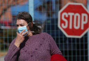 A woman wears a protective face mask as she exits Attiko hospital, where the first confirmed, in Athens and the third in Greece coronavirus COVID-19 case is being treated, in Athens, Greece, 27 February 2020.The first coronavirus case in Athens is confirmed, Greece - 27 Feb 2020
