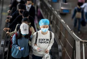 People wearing face masks ride an escalator at the High Speed Railway Station in Guangzhou, Guangdong province, China, 12 March 2020. Daily life in China has been heavily affected by the outbreak of the COVID-19 disease caused by the SARS-CoV-2 coronavirus, which originated in the Chinese city of Wuhan and spread around the world with China, Italy, Iran, and South Korea heavily affected. The disease has so far killed at least 4,600 people and infected over 123,000 others worldwide.China Covid 19 epidemic daily life, Guangzhou - 12 Mar 2020