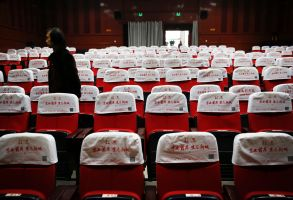 Wang Xudong, the manager of Zhuolu County Digital Cinema, checks on the main screening hall in Zhuolu county in north China's Hebei province. The brightly-decorated 3-D cinema in this town outside Beijing is showing the latest Chinese and Hollywood films, to row after row of empty red seats. So few people come to watch films here that the theater manager rents out the halls to travelling sales companies or music teachersBiggest Cinema Market, Beijing, China - 12 Dec 2016