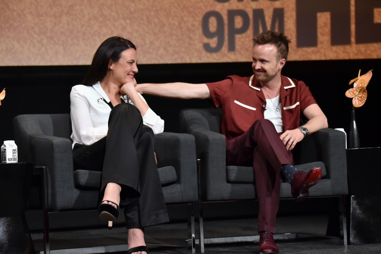 """NORTH HOLLYWOOD, CALIFORNIA - MARCH 06: (L-R) Lisa Joy and Aaron Paul speak onstage during the screening & panel discussion of the HBO drama series """"Westworld"""" at Wolf Theatre on March 06, 2020 in North Hollywood, California. (Photo by Jeff Kravitz/FilmMagic for HBO)"""